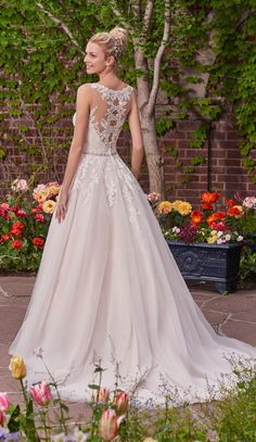 You don't have to compromise style for your budget with a gown by Rebecca Ingram!