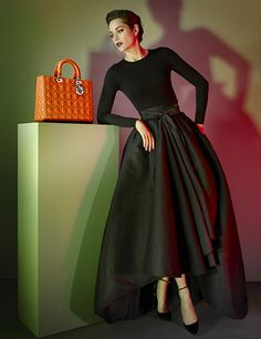 This image for Dior of Marion Cotillard by Jean Baptiste Mondino is a good example of the use of Split-Complementary Colours. Red and orange are used together to offset against the green base colour. The result is contrasting, whilst remaining harmonious.