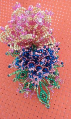 Tembleque tapamoño a colores con swarosky y perlas de vidrio