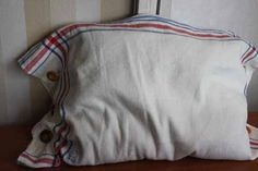 Cushion made of vintage towels with buttons by ReDesignandReCycled, kr240.00