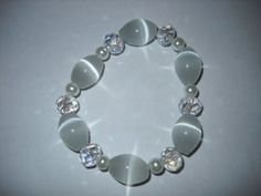 White Cat's Eye Crystal and Pearl Stretch Bracelet by danielleh08, $8.00