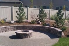 I love how the retaining wall acts as a seating area around the fire pit in this backyard.  My family loves spending time outside and would love to do something like this in our yard.  I think it would be great for summer nights.