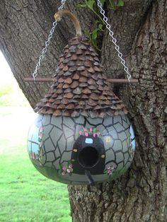A Beautiful and Unique Old English Greystone Cottage Birdhouse Gourd and the roof is made of all pinecones ! Your feather friends are gonna