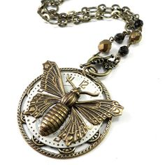 Clockwork Necklace - Metallic Watch Dial - Gold Butterfly - Refined Steampunk   http://www.compassrosedesignjewelry.com/collections/clockwork-steampunk-necklaces?page=3
