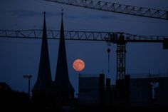 This weekend's supermoon was 14% bigger and 30% brighter. Here are some of the best shots from around the world.