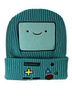 Bmo Adventure Time Beanie - This is a blue beaning with a square face on the middle and with yellow, red, green and black buttons on the rim and a face with a lighter blue and black eyes and mouth and a black border. I just really like adventure time.
