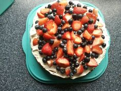 Lemon drizzle cake with whipped cream and fresh berries - yummy especially in summer!