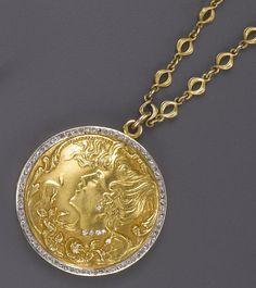 An art nouveau gold and diamond locket necklace, circa 1895 /1910