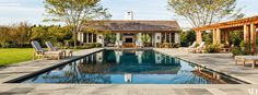 Bluestone pavers surround the saltwater pool. The Munder-Skiles chaise longues are cushioned in a Perennials fabric.