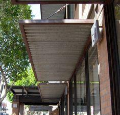 Wood frame match of matching burnt wood, corrugated metal on underside