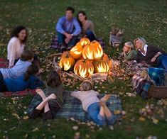 Don't have a fire pit? Carve flames into pumpkins, stack them up, and enjoy the fire! | Living the Country Life | http://www.livingthecountrylife.com/country-life/halloween-in-the-country/