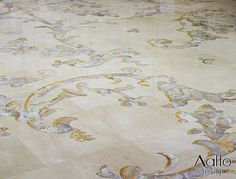 White Onyx inlaid into Crema Marfil creates a contemporary all over floor pattern.