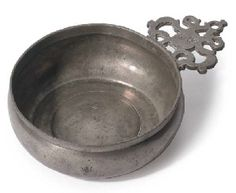 AN ENGLISH PEWTER PORRINGER  CIRCA 1670  With rounded bowl and booge and single 'Old English' style ear, owners initials 'MG' on ear, touch in bowl of the maker 'S.B.' (O.P.5459),  7in. (18cm.) overall diameter  5k English Style, Old English, Norwegian Wedding, Tin Art, Zinn, Scandinavian Art, Antique Bottles, Look Vintage, Antique Pewter