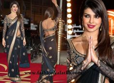 Priyanka Chopra spotted Dressed up in Indian trendy Saree at Marrakech International Film Festival . Draped in a black color georgette saree with amazing embroidery blouse. Its net fabric with thread and resham embroidery.