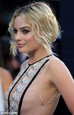 Margot Robbie flashes a hint of her sideboob in optical illusion nude and black embellished dress at Tarzan premiere | Daily Mail Online