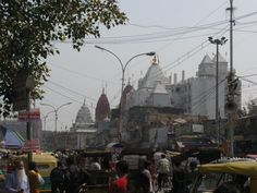 Chandni Chowk Delhi - This picture is true capture of India and its secular state - with Sarwa Dharma Sambhav - This street has Gurudwara, Church, Temples, Lal Mandir a Jain Temple and in front we have our Red Fort , clearly symbolizing India - Sarwa Dharma Sambhav. In this picture you can see Gumbad from different places of workship in a single row.
