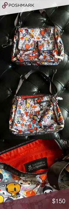 Tokidoki for LeSportsac Inferno Print Rare hard to find print from 2006! No rips! In good used conditions. Some marks in the interior as photographed but one of the most durable bags I've owned. Qee charm has a missing arm. -Adjustable strap -Washable  ::Comes from a smoke and pet free home:: tokidoki Bags Baby Bags