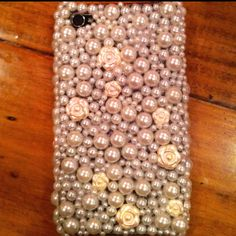 Pearl phone cover. Used half-back pearls from scrapbooking section and hot glued onto a clear phone cover. Sealed with clear nail polish and let dry over night. I love it!!!