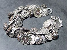 Vintage Button Bracelet Silver Metal and Pewter. $79.00, via Etsy.