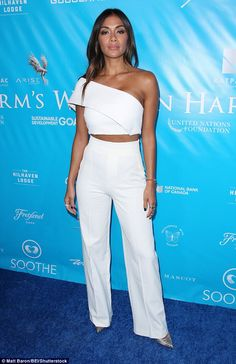 It takes two to tango: The 38-year-old beauty looked sultry in a two-piece white ensemble featuring a one-sleeve crop top and high-waist trousers