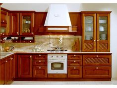 Our RD Department designed a new style kitchen cabinet which is solid wood door with drawers and glass doors. Name:Cherry wooden kitchen cabinet American style Products details Features: Kitchen CabinetVC-KS-SO According to environmental protection Solid Wood Kitchen Cabinets, Solid Wood Kitchens, Kitchen Cabinet Styles, Mission Style Kitchens, Cherry Kitchen, Wood Doors, Home Kitchens, House Ideas, China