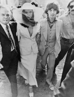 """Yves Saint Laurent designed a """"long, narrow skirt and jacket"""" instead of a wedding dress for the chic Bianca Jagger."""