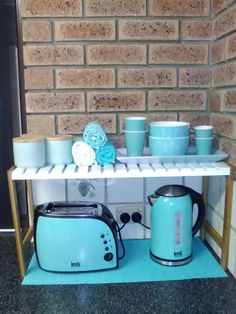 Kmart stand with spotlight teal toaster and jug