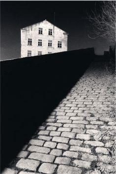 Bill Brandt's Snicket, Halifax, Yorkshire. Photo by Michael Kenna, 1986. Really like the composition of this image with the white building and the dark wall.