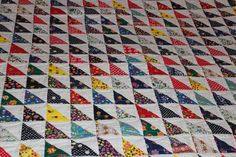 A personal favorite from my Etsy shop https://www.etsy.com/listing/256891972/free-motion-quilted-half-square-triangle