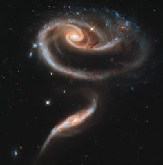 Hubble image of a pair of dancing galaxies called Arp 273 that looks like a rose