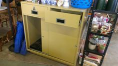 Super cool metal cabinet just waiting to be refinished...perfect as a small kitchen island!