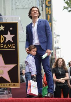 Actor Orlando Bloom and his son Flynn Bloom attend the Hollywood Walk of Fame celebration in honor of Orlando Bloom on April 2, 2014 in Hollywood, California.