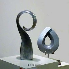 Two abstract sculptures in clay with patina by Anne Beaurin of the Hangar Artists - Abstract Vibrations IV