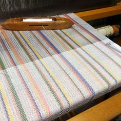 I got a new towel warp on the loom - plain weave and 3/1 twill. The colors are to coordinate with the recently woven table runners (still waiting to be hand-hemmed). Above is actually the backside of