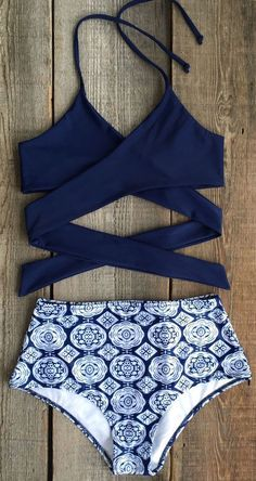With its dark sea #blue hue and floaty fabric, nothing says… #bikini #2017