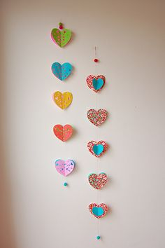 DIY Paper Heart Garland by Betweenthelines: So lovely, I would keep it hanging all year long!