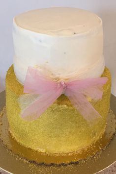 Gold Cake with Pink Tulle Bow