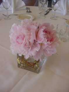 3 or 4 peonies arranged in a square vase - we'll have 2 of these on either side of lanterns.