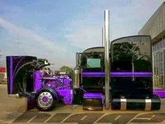 Custom Peterbilt in black and purple with straight stacks and painted tanks...Stunning!
