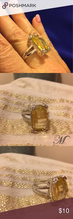 Pretty yellow Topaz Statement Ring It is suggested that wearing yellow enhances one's wisdom, clarity, and self-esteem. Yellow is seen as a cheerful color and wearing a pendant, ring or earrings with yellow gemstones can help brighten the day making the wearer feel more optimistic and confident. Jewelry Rings