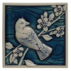 The Rookwood Songbird Series is a set of four tiles by noted naturalist artist John Beasley. Mr. Beasley depicts each bird in its natural setting, showcasing his love of birds, talent for fine detail