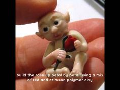Sculpting a micro miniature polymer clay fairy baby with a tiny rosebud in hand