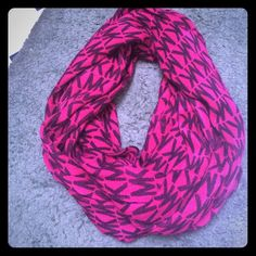 MICHAEL KORS INFINITY SCARF Very lightly worn. Hot pink and black Michael KORS scarf. Michael Kors Accessories Scarves & Wraps