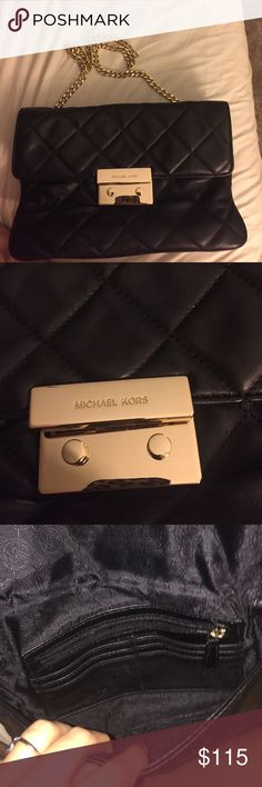 Michael kors clutch Michael Kors quilted clutch in black.. also has a gold chain that could be used. Perfect condition Michael Kors Bags Clutches & Wristlets
