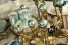 Possible Christmas centerpiece - vintage ornaments on brass candlesticks