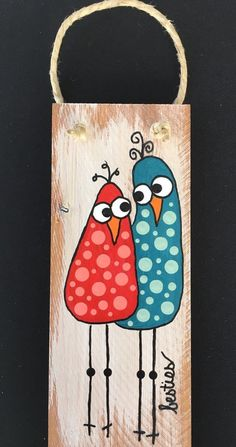 """Whimsical """"BESTIES"""" from our """"Birds of a Feather"""" collection. These best fine feathered friends are painted on 7.25""""x 2.75"""" piece of cherry wood. Natural polished hemp cord for hanging.  Need a different saying? Different colors? Different number of birds? Just drop us a line - we"""