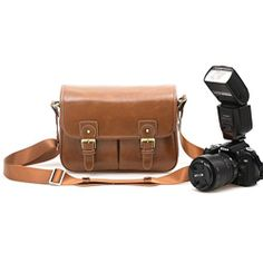 Waterproof Vintage Faux Leather and Canvas Camera Bag Messenger Bag for DSLR Camera and Lens Travel Camel ZLYC http://www.amazon.co.uk/dp/B00LGH4HPU/ref=cm_sw_r_pi_dp_xd8Stb1HFY8EDRFW