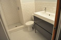 IKEA vanity, subway tile, make shower smaller- but with more storage