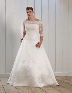 Pretty in plus wedding gown. Love the neckline and lace sleeves