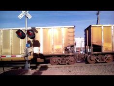 BNSF is carrying a empty coal train on railroad crossing